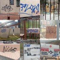 Detall de les múltiples pintades al mobiliari urbà la nit del 28 de febrer